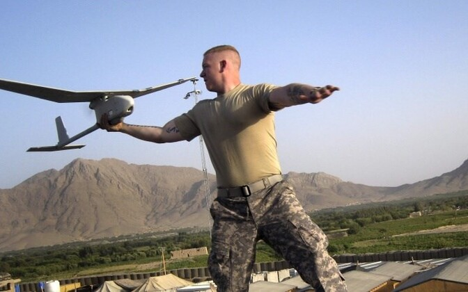 A Raven UAV being launched by a US soldier in Afghanistan