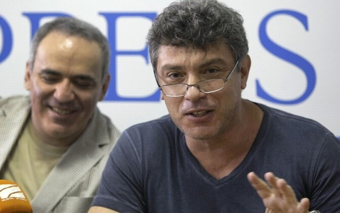 Russia's opposition leader Boris Nemtsov (right), recently hit with a travel ban