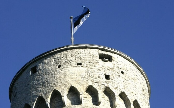 Estonian national flag flying on the Tall Hermann tower in Tallinn.