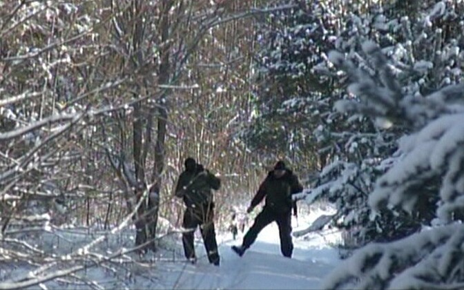Border guards in the woods