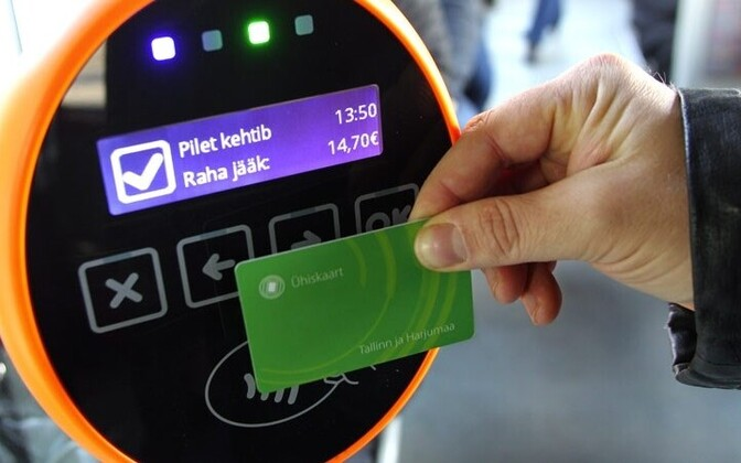 A rider validating a Smartcard on public transport in Tallinn.