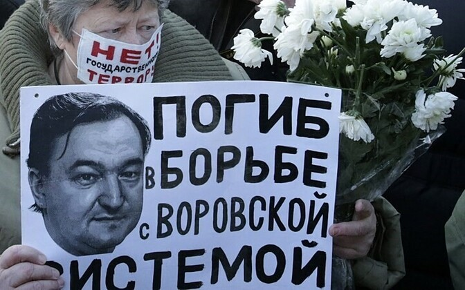 Woman with a portrait of Sergei Magnitsky at a protest march in Moscow.
