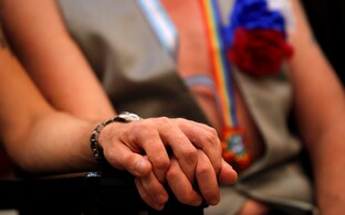 Same-sex couple holding hands. Photo is illustrative.