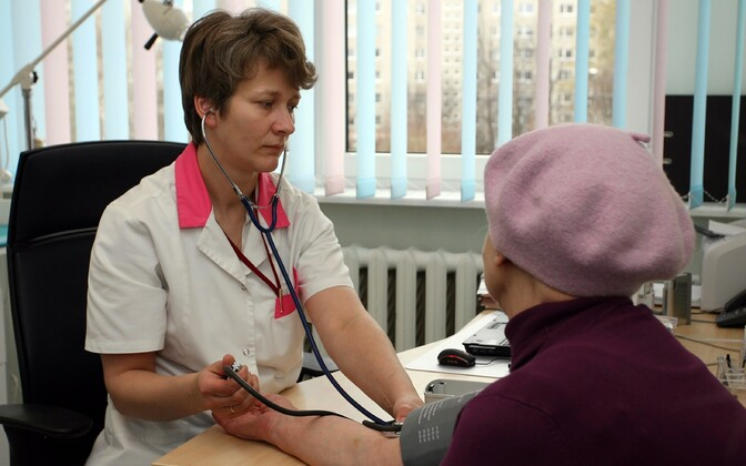 A doctor checking her patient's blood pressure. Photo is illustrative.