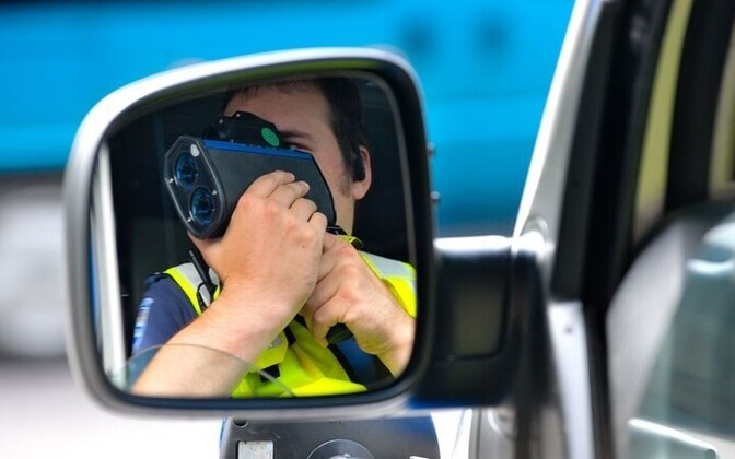 Police recording vehicle speeds. Photo is illustrative.