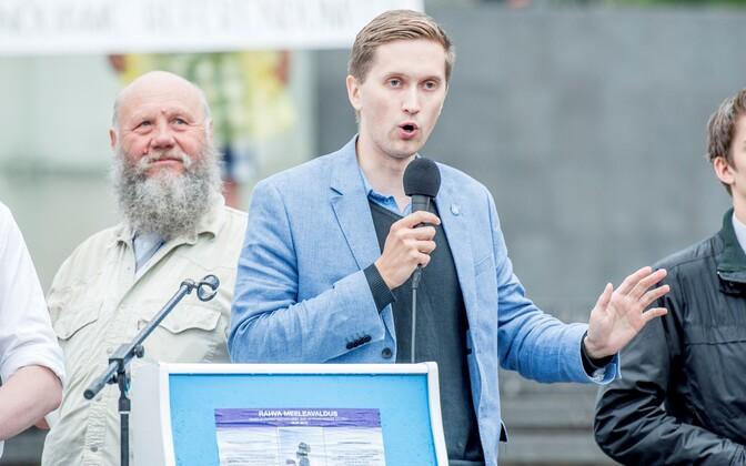 EKRE MP Jaak Madison speaking at the anti-immigration rally in Tallinn