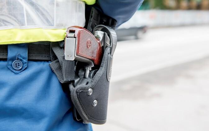 A law enforcement officer's pistol.