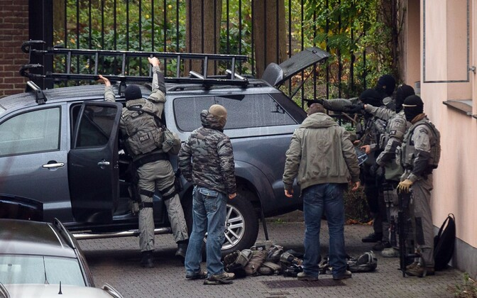 Belgian police conducting an anti-terrorism raid in Molenbeek district in Brussels