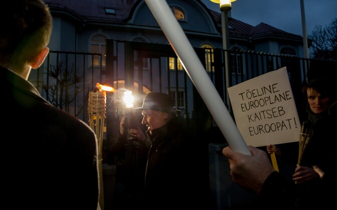 Part of the repertoire: Sinine Äratus with torches at the French embassy, protesting the country's Mistral deal with Russia, November 2014