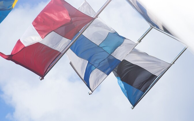 Flags of the three countries currently in somewhat of a game of pass-the-parcel with alcohol excise duties. From left, Latvia, Finland and Estonia.