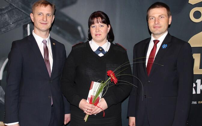 OLE juhatuse esimees Tamo Vahemets, Anne Kuuskmann ja siseminister Hanno Pevkur.