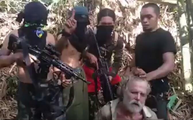 Abu Sayyafi terroristid ähvardusi tegemas.