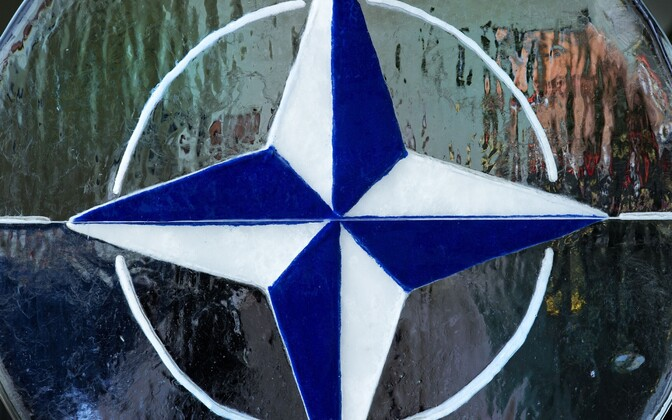 NATO logo.