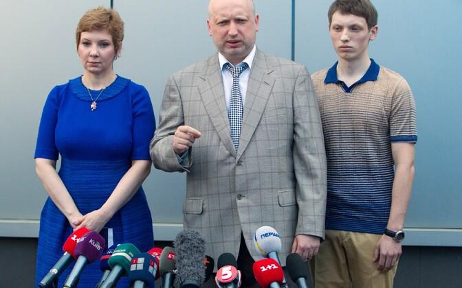Vasakult: Anna Turtsõnova, Oleksandr Turtšõnov ja nende poeg Kirill, arhiivifoto.
