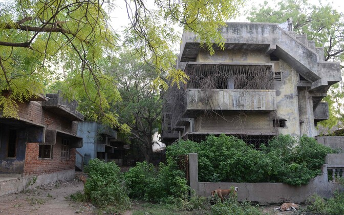 Usurahutuste ajal kahjustada saanud hooned Ahmedabadis Indias.