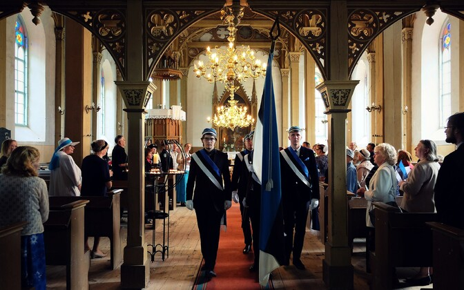 The Estonian Students' Society's color guard exits Otepää St. Mary's Lutheran Church after the Flag Day concert-service ends.