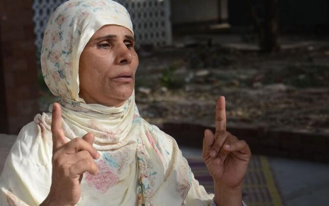 Perveen Rafiq, kes oma tütre väidetavalt põlema süütas.