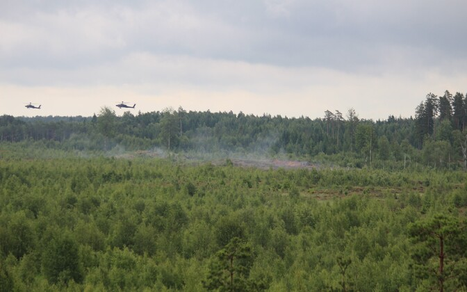 Apache helictopters firing at their targets