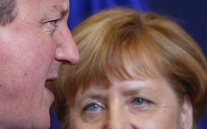 British Prime Minister Cameron and German Chancellor Merkel take part in a group photo at a European Union leaders summit addressing Brexit and the migrants crisis in Brussels, Feb. 18, 2016.