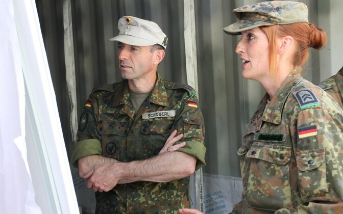 Commander of the Gebirgsjägerbatallion 231, Lt. Col. Arno Schöberl (left), inspects preparations to move the battalion's equipment to Estonia
