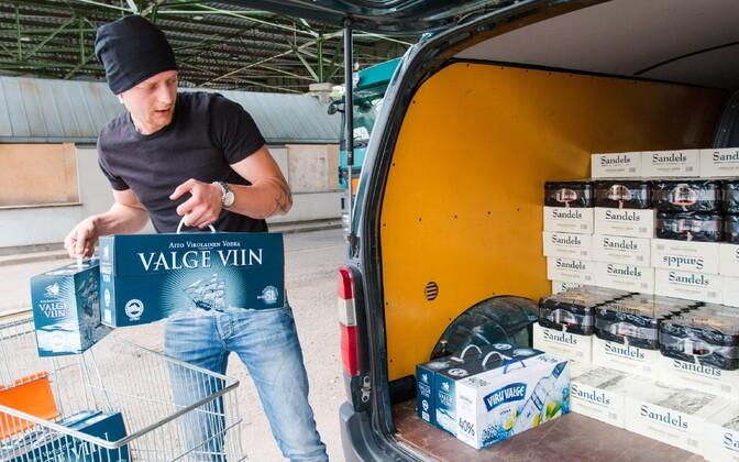 An Estonian stocking up on beer and hard liquor at a Latvian liquor store.