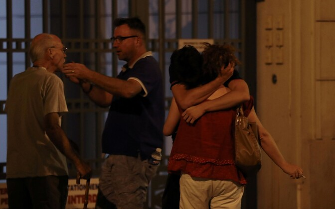 People in Nice consoling one another after a terrorist attack on the night of Bastille Day killed over 80 people and injured more than 100.