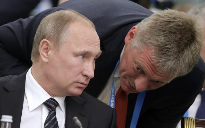 President Vladimir Putin ja Dmitri Peskov.