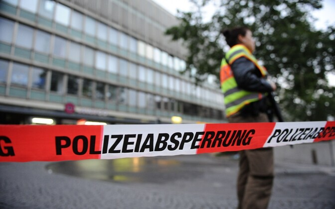 Police tape cordons off areas around the Olympia Shopping Center (OEZ) in Munich after a Friday evening shooting claimed ten lives and injured at least 16.