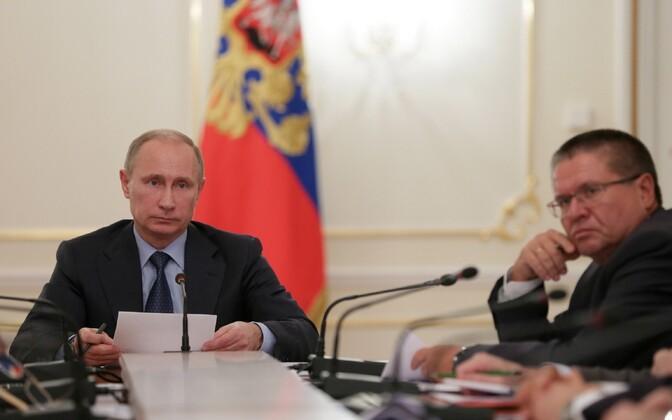 Venemaa president Vladimir Putin ja majandusminister Aleksei Uljukajev.