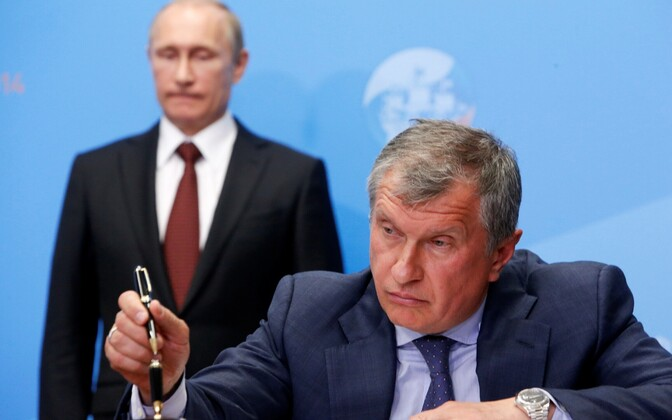 Rosnefti juht Igor Setšin, taustal Venemaa president Vladimir Putin.