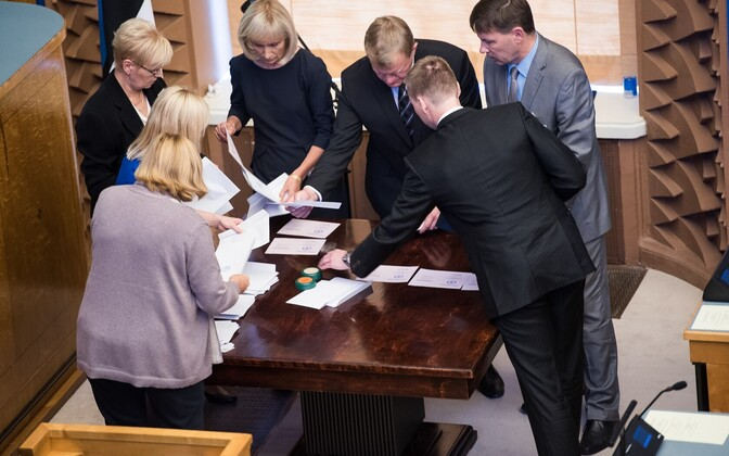 Members of the Estonian Electoral Committee counting paper ballots after the second round of voting in the Riigikogu.