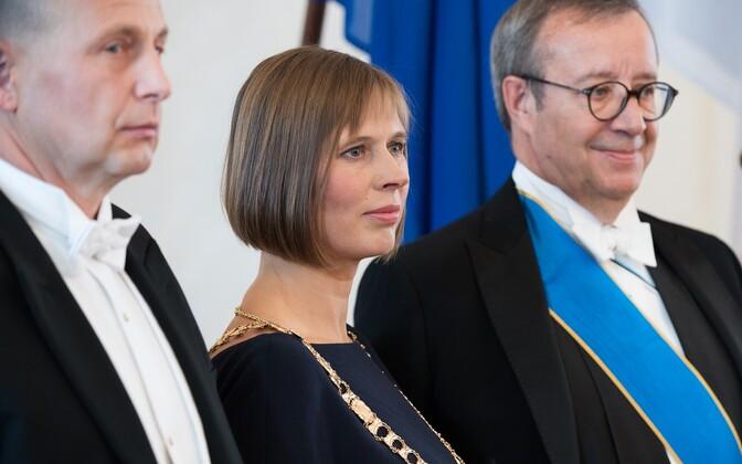 President Kersti Kaljulaid (center) with her husband Georgi-Rene Maksimovski (left) and former President Toomas Hendrik Ilves (right) on the day of her inauguration.