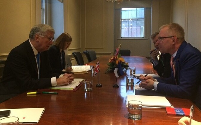 Defence Minister Hannes Hanso (right) meeting his British colleague, Michael Fallon.