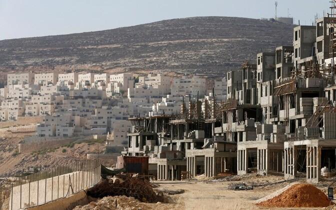 Строительство израильского поселения на Западном берегу реки Иордан.