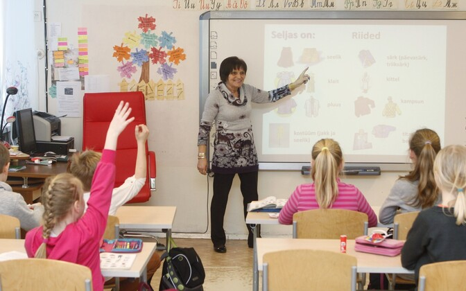 Teacher teaching a third grade class. Photo is illustrative.