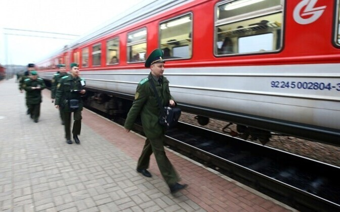 Belorussian border guard officials about to inspect a train at the Lithuanian border.