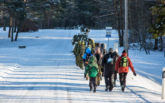 Local schoolchildren join U.S. and Estonian soldiers on the Winter March. Feb. 7, 2017.