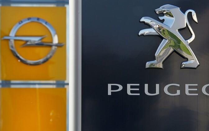Логотипы Opel и Peugeot.