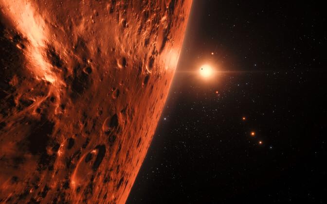 TRAPPIST-1 planeedisüsteem kunstniku nägemuses.