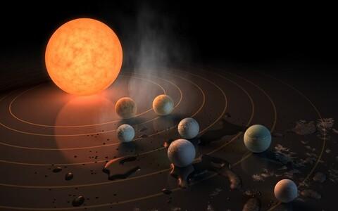 TRAPPIST--1 süsteem kunstniku nägemuses.