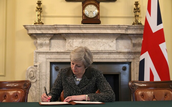 British Prime Minister Theresa May signed the document triggering the U.K.s exit from the EU on Tuesday night. March 28, 2017.
