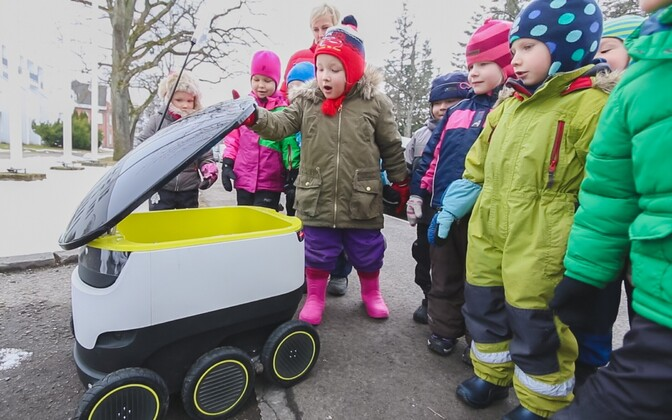 A package delivery robot vehicle developed by Starship Technologies being investigated by preschool children in Pärnu.