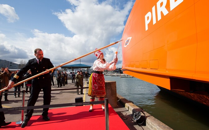 Muhu native Mareli Ots christening the Piret in Tallinn's Old City Harbour on Wednesday. April 12, 2017.