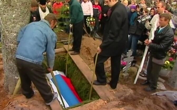 At Dmitri Ganin's funeral.