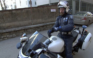 Estonian police officer on a motorcycle.