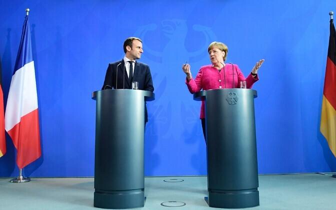 Макрон и Меркель на встрече 15 мая.
