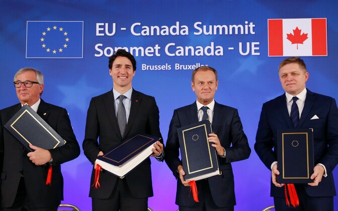 President of the European Commission Jean-Claude Juncker, Canadian Prime Minister Justin Trudeau, EU Council President Donald Tusk and Slovak Prime Minister Robert Fico at the CETA signing ceremony in Brussel. Oct. 30, 2016.