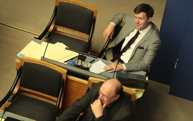 Martin (back) and Mart Helme (EKRE) during May 17's marathon sitting of the Riigikogu. EKRE proposed to dismiss the Rail Baltic ratification bill, but failed.
