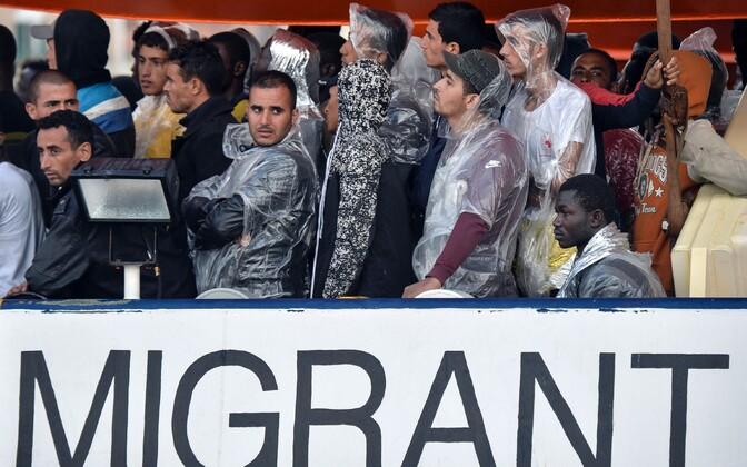 Беженцы в Италии.