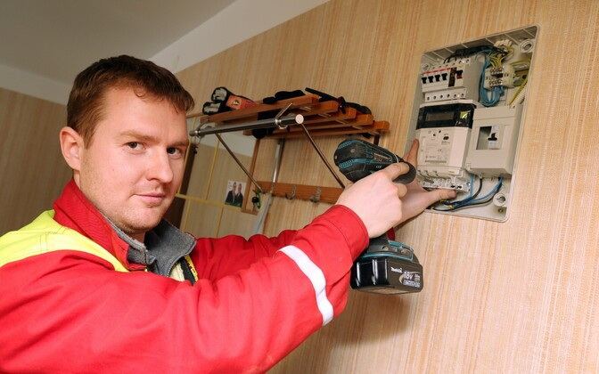 Remote-read electric meter being installed.